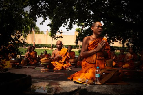 monks-wearing-orange-robe-mediating-2421470